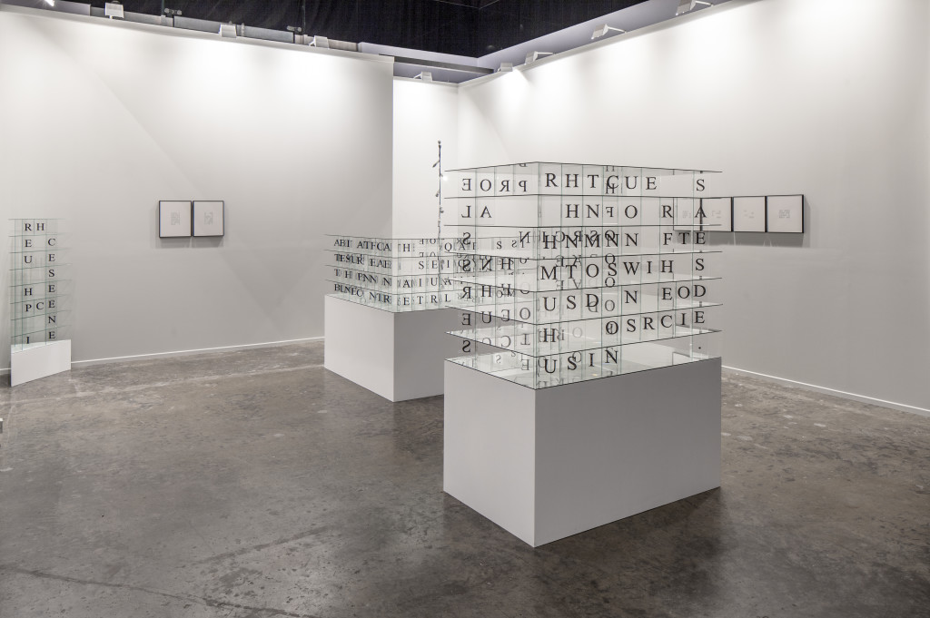 Marlon de Azambuja, Edicto, (2015) permanent marker on crystal and wooden base, installation view, Art Dubai 2015