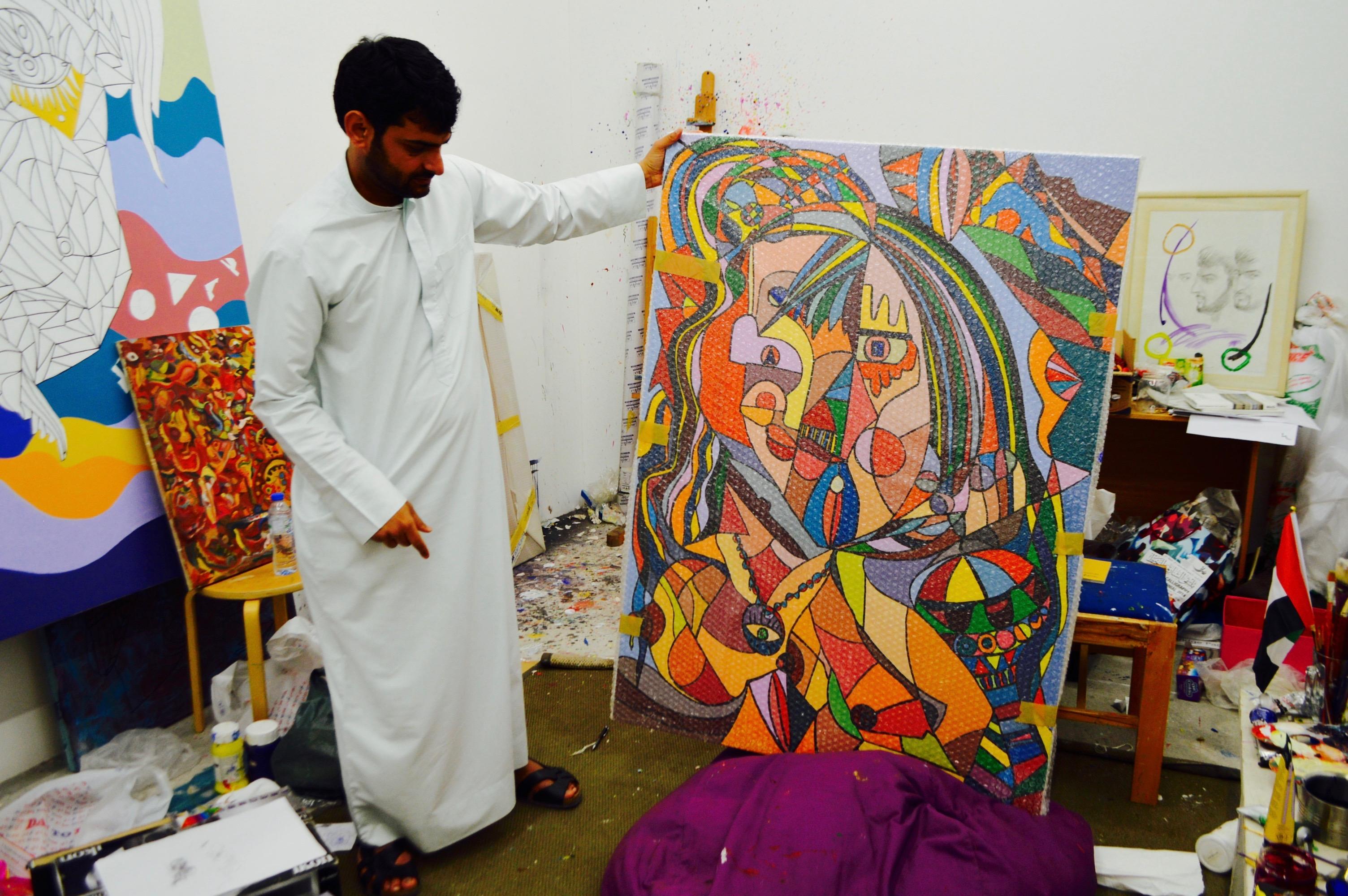 Abdul Rahman Al Maa'ini in his studio with a work in progress. Courtesy of the Barjeel Foundation.