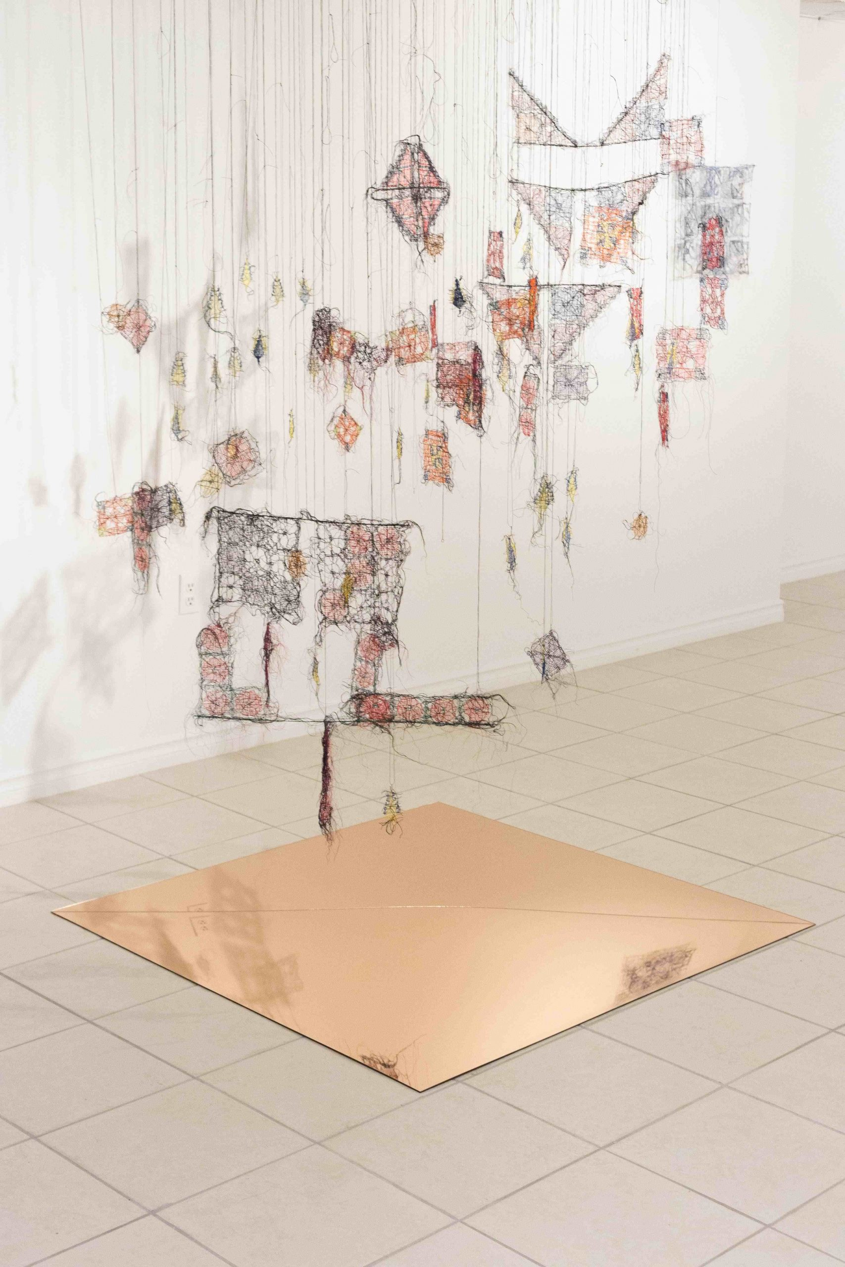 Transgressed Boundaries Installation, 2020, thread, mirrored plexiglass, 1.5 x 1.5 x 2.5 cm