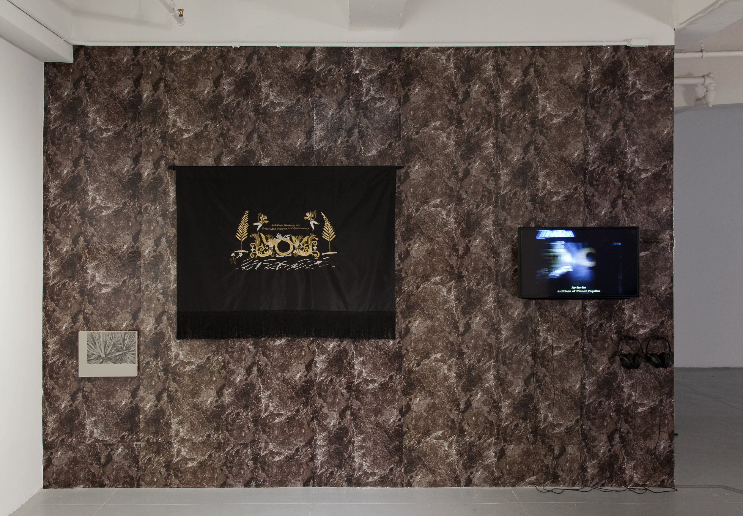 Installation view, Uncanny Gardening II, wallpaper, gesso resin and graphite on a wood panel, gold thread on silk, single channel video