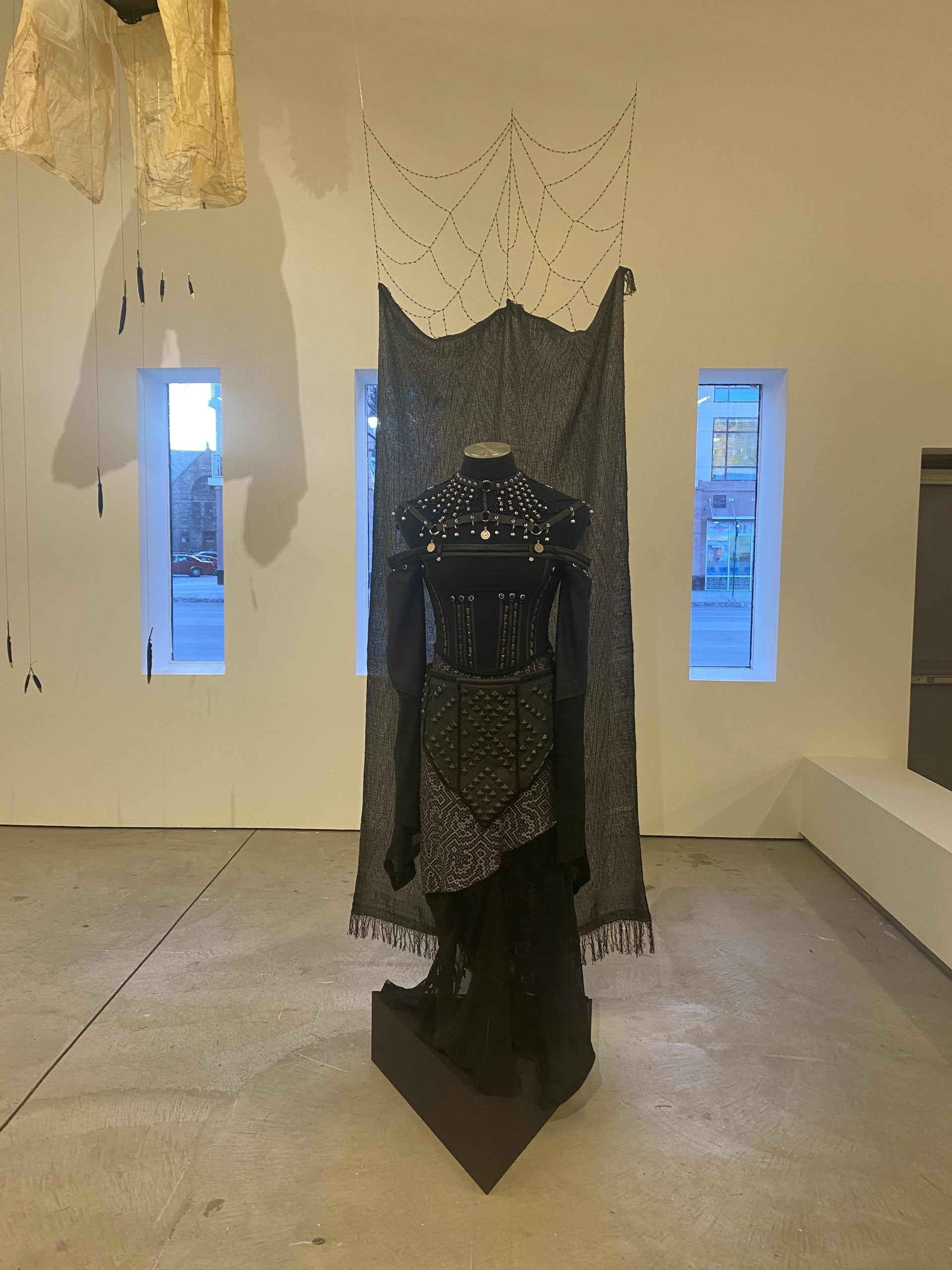 Vanagad, 2021, Handwoven silk, beads, studs, leather, mesh, chain, coins, found corset safety pins (web), 10 x 2 ft. Museum of Contemporary Art Detroit