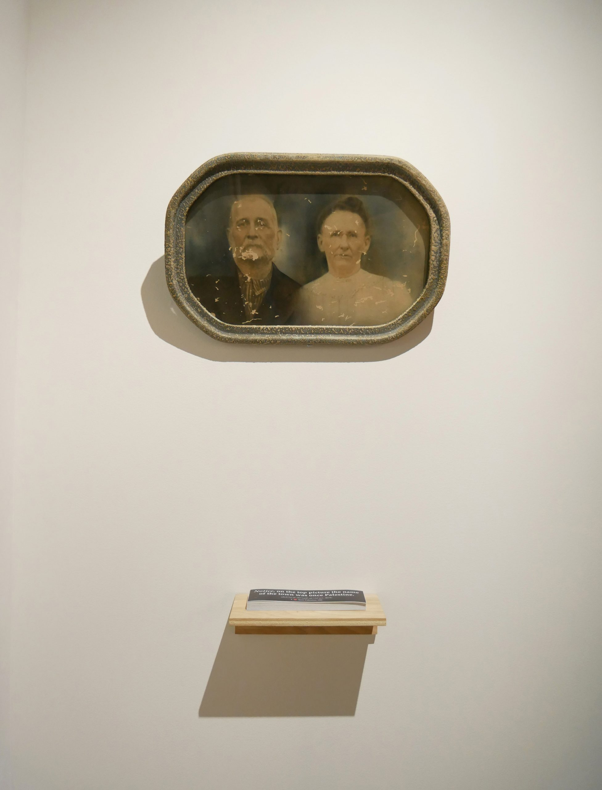 Lost Old Couple circa 1900, found at 25 E. Mill St. New Palestine, IN in a trash can by Garth Castleman, around 2010, found object.  Billboard in New Palestine, IN, bumper sticker, takeaway, Michigan State University Union Art Gallery 2019.