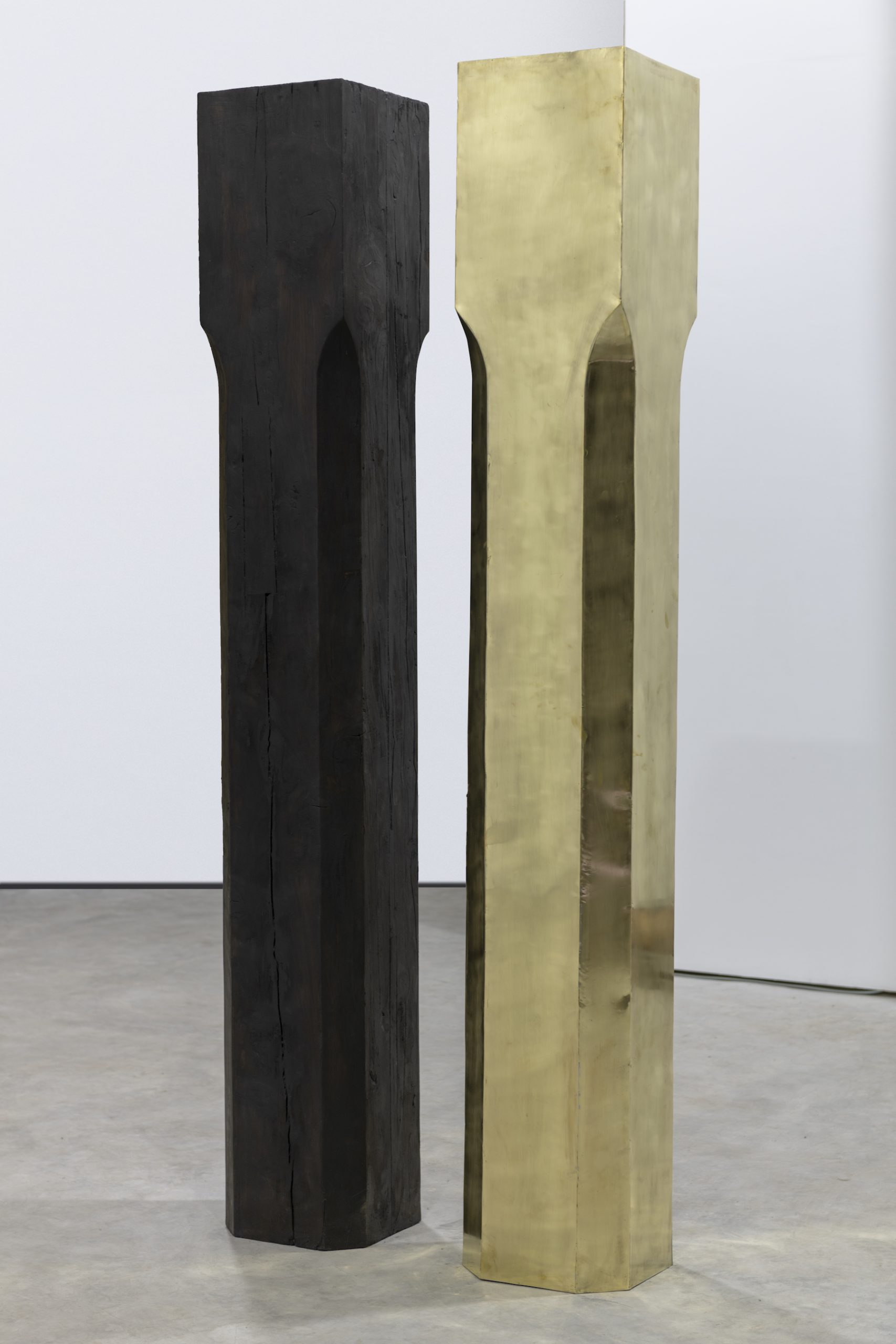 Re-enactment Act II, 2020, Burnt wood and yellow copper, 30 x 30 x 200 cm (each)