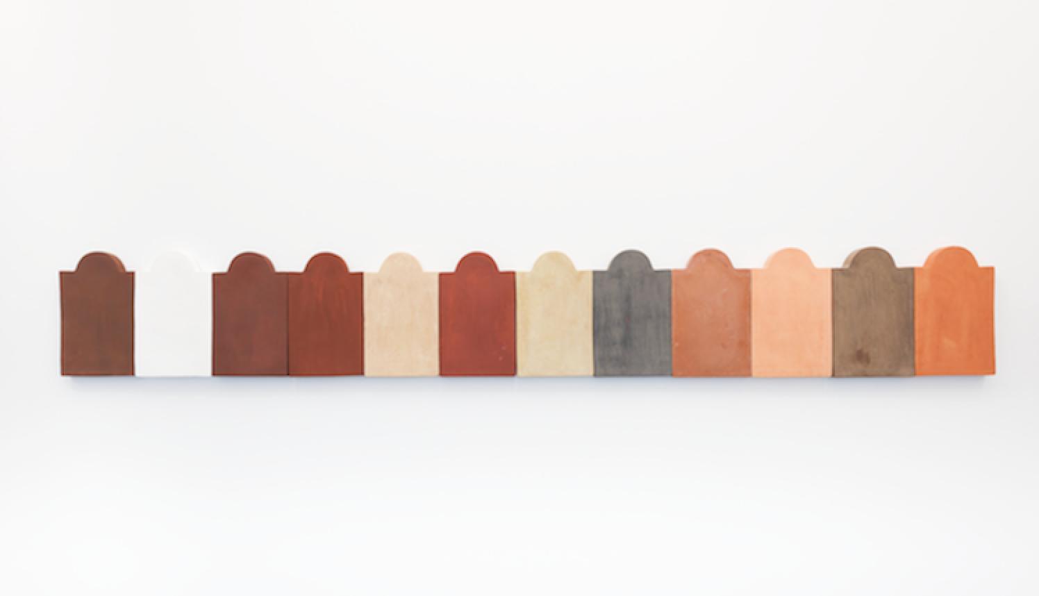 Nous sommes tous fait de terre I, 2019, Terracotta and engobe, 35 x 256 x 3 cm